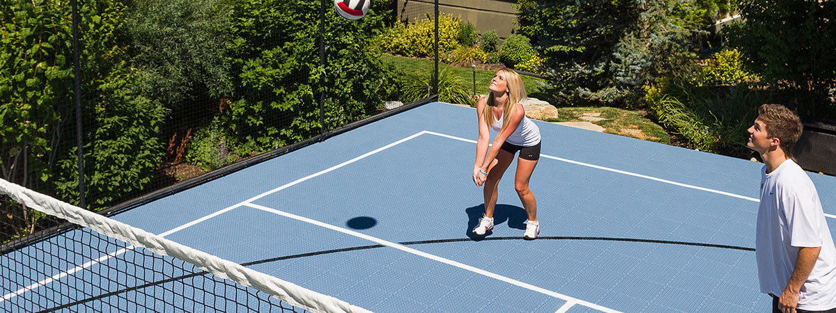 Friends playing volleyball on a backyard volleyball court